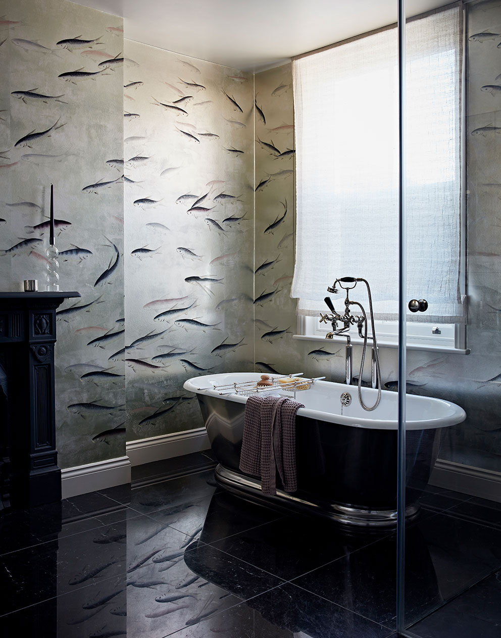 Queens Park roll top bath with fish wallpaper