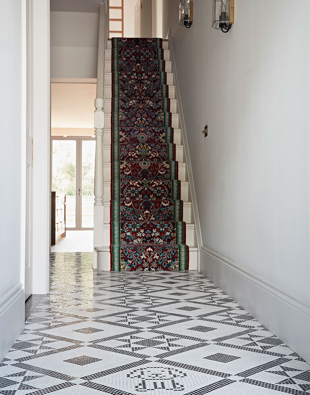 Queens Park hallway with tiled floor and carpet runner up the stairs