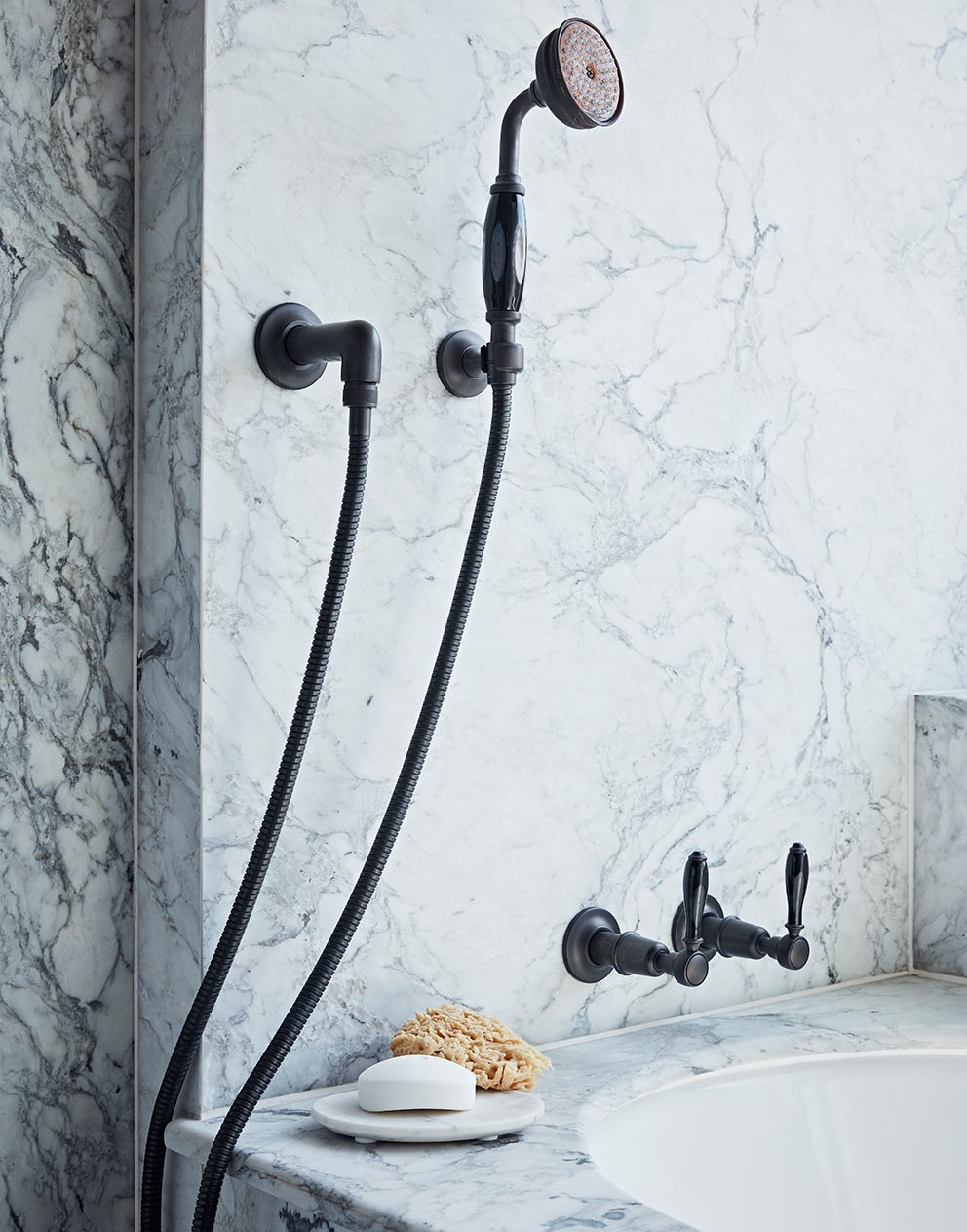 Executive suite marble bathroom and dark metal shower fitting