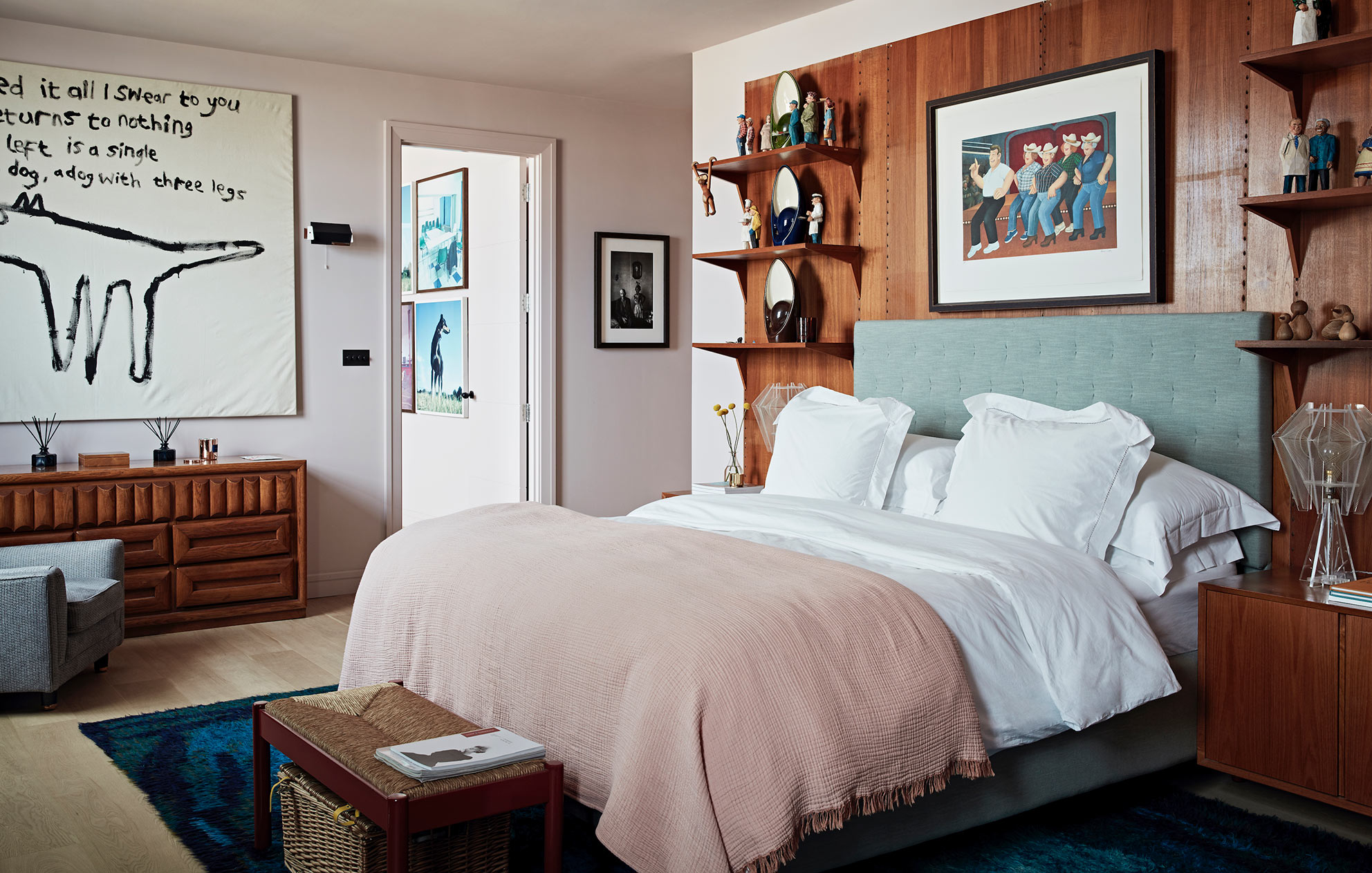 West London pied-a-terre bedroom with wooden bed surround