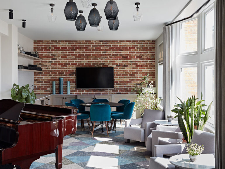 Really Useful Group London HQ meeting space with grand piano and bespoke interior design