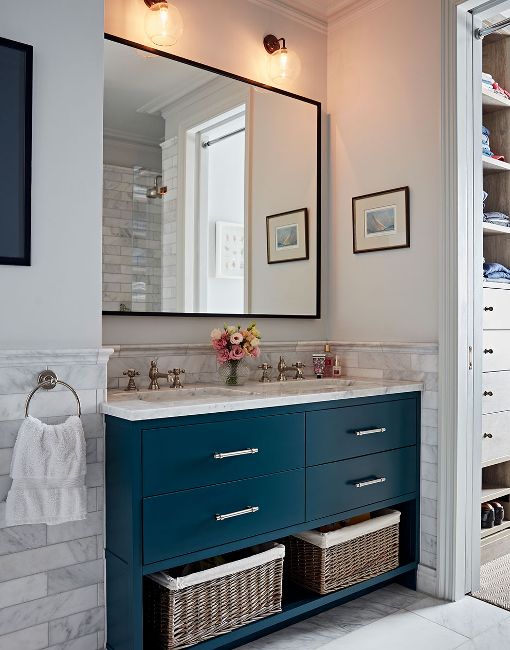 Modern designer bathroom with marble sink and tiles