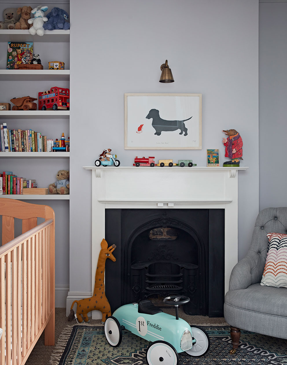 Child's room with grey walls and chair, filled with brightly coloured toys