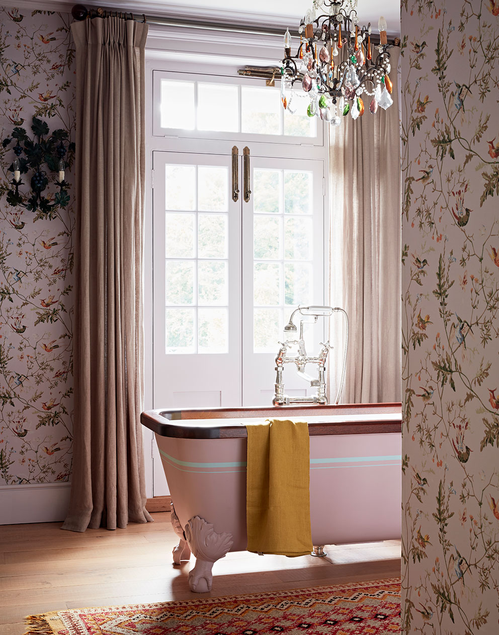 Pastel coloured bespoke stylish pink bathroom with glass chandelier