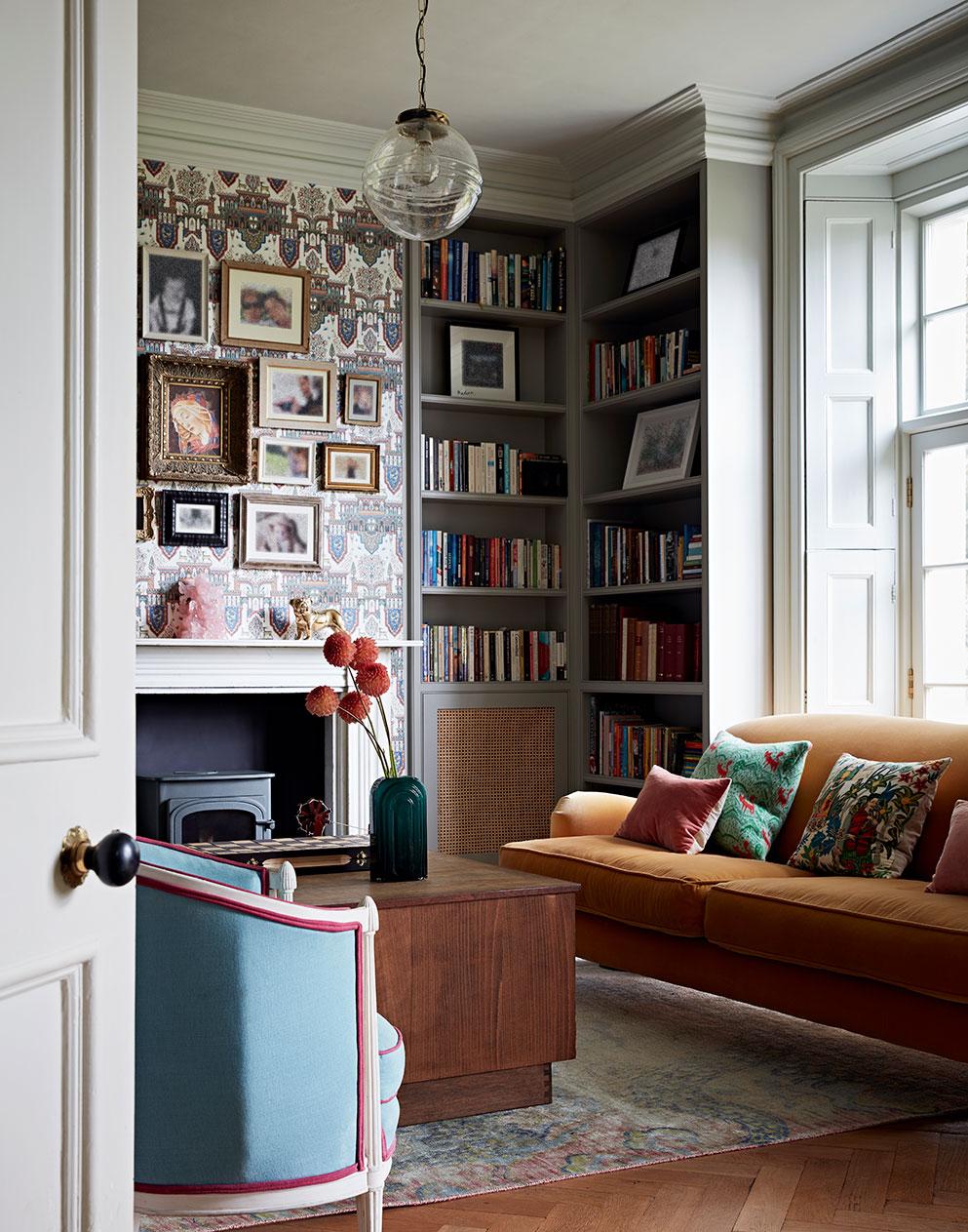 Stunning living room with orange velvet sofa