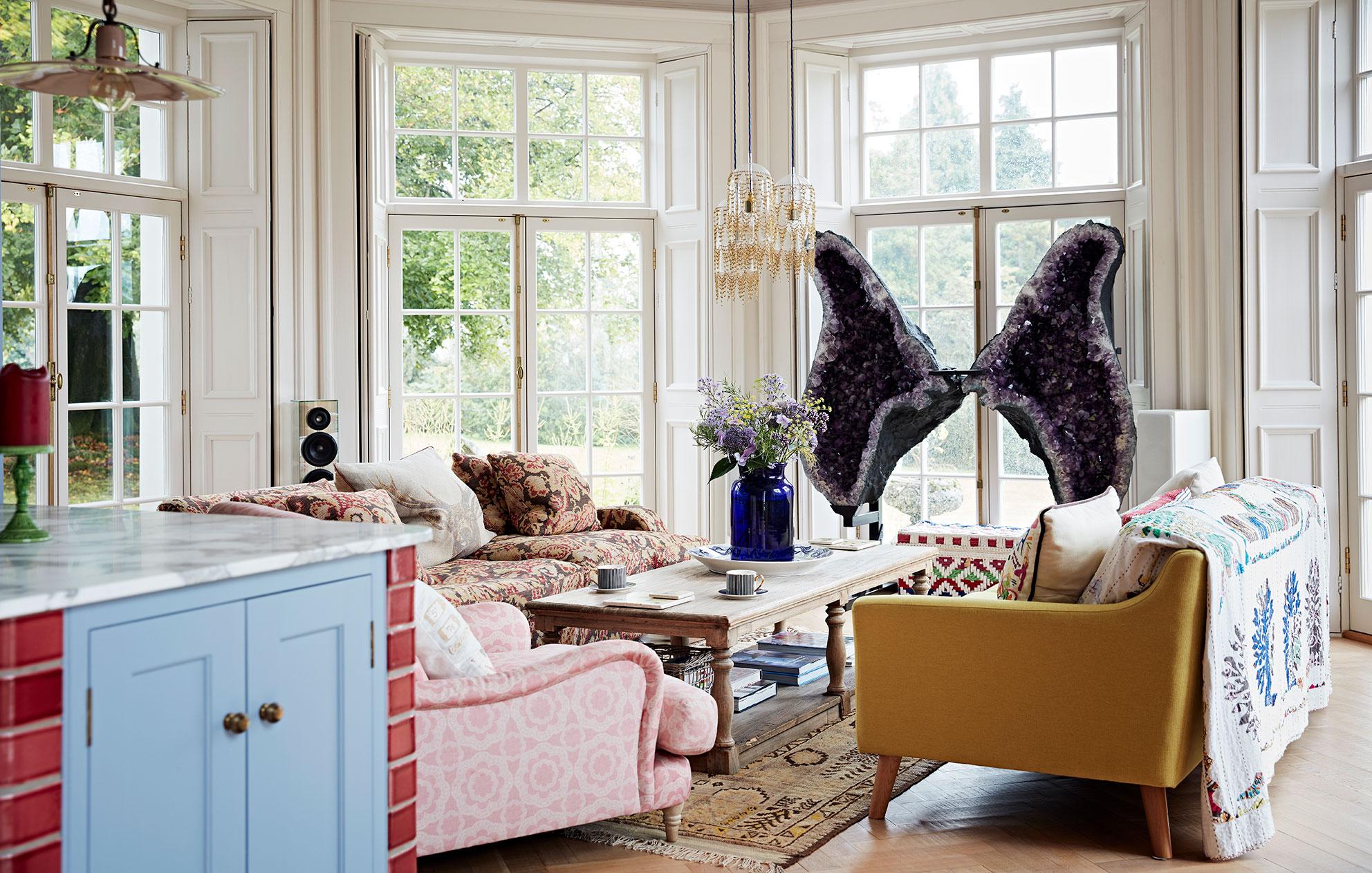 Huge quartz sculpture in window of a light-filled living room