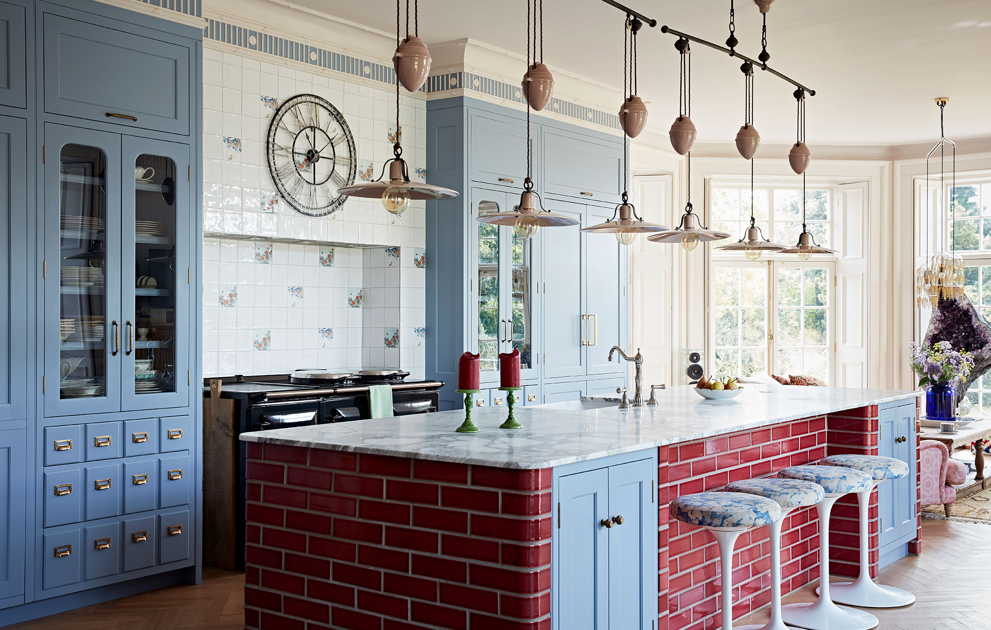 Bespoke interior designed kitchen with maroon tiles and cornflower blue cupboards