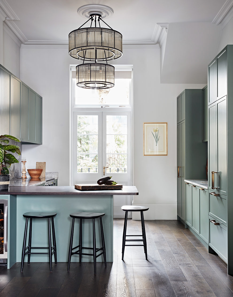 Bespoke kitchen with high ceilings and unusual chandelier